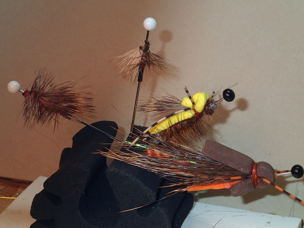 Some routine dry fly patterns from left to right: Stimulator, Elk hair caddis, foam hopper and Prom Queen