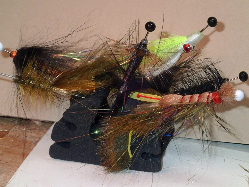 Some routine wet patterns from left to right: Olive bugger, Leech, Brooks stone, Clouser, black bugger, crayfish