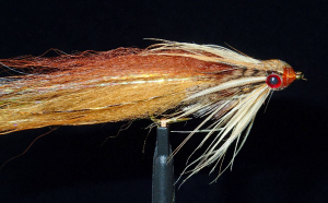 Brown and tan fur featherhead with partridge hackle